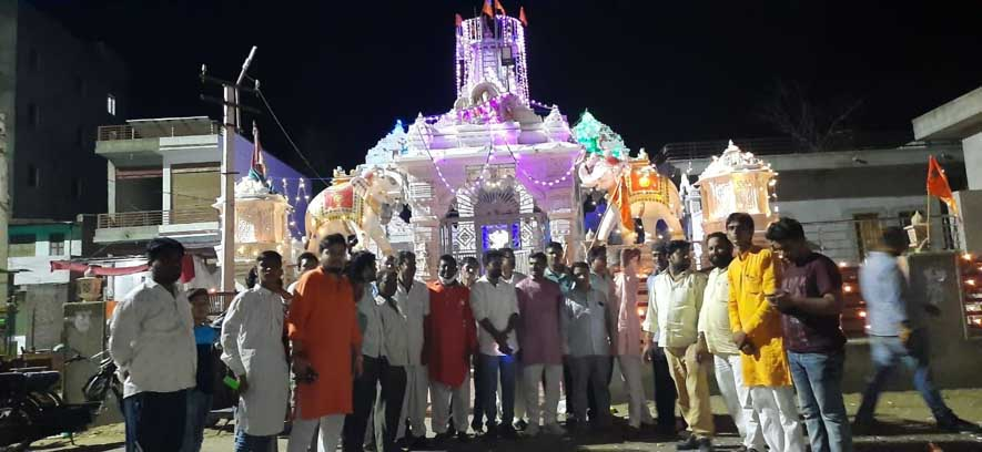 Ayala is illuminated by lamps in the joy of Ram temple foundation stone